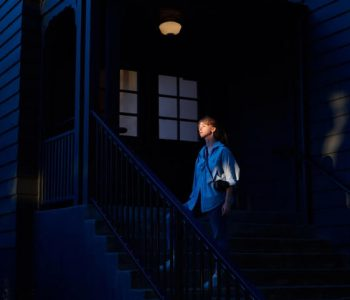 woman-on-house-entrance-stairs-at-night-4353714